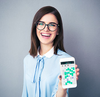 Smiling optician managing her appointments on Planfy using her smartphone.