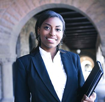 Young female lawyer with documents attending a legal consultation.
